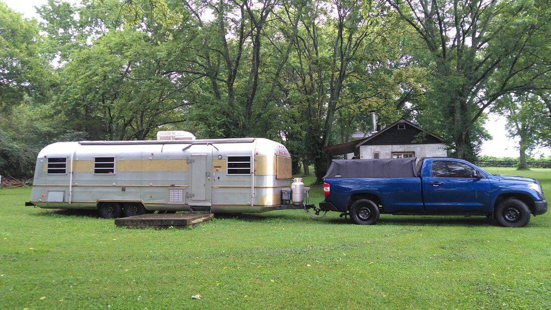 blue truck with travel trailer
